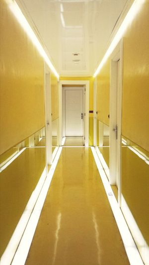 yellow floor at Art Hotel by Spanish steps, Rome, Italy (no filter, no edit) Symmetrical The Five Senses Color Explosion Interior Geometry Lemon By Motorola Travel Yellow Hotel Corridor Hotel Art By Spanish Rome Hotels In The World