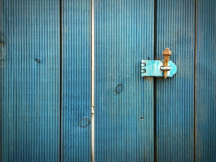 Full frame of blue wooden door