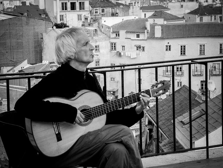 An elder guitarist plays a mellow and charming tune to the silence of Alfama, Lisbon's old town area. - Circa 2008 Alfama Lisboa Portugal Lisbon - Portugal Lisbonlovers Old Man Charming Elderly Elderly Man Guitar Guitar Love Guitar Player Guitarist Guitars Lisboa Lisboalive Lisbon Music Musical Instrument Musician Outdoors Playing Street Street Photography Streetphoto_bw Streetphotography