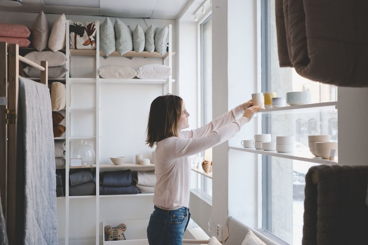 Rear view of woman standing at home