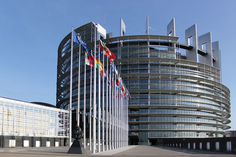 European Parliament in Strasbourg, France Built Structure Building Exterior Architecture Sky Office Building Exterior Building Low Angle View City Modern No People Nature Clear Sky Day Tall - High Glass - Material Skyscraper Outdoors Flag European Union European Parlament Strasbourg European Parliament Democracy