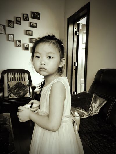 Real People Girls Childhood Elementary Age One Person Indoors  Home Interior Looking At Camera Holding Leisure Activity Standing Portrait Day The Human Condition
