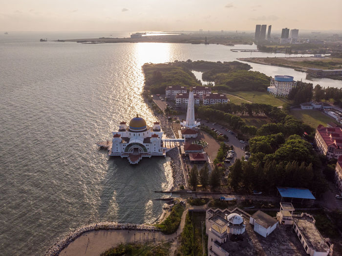 Melaka Straits Mosque, Malaysia Water Architecture Built Structure Building Exterior Nature High Angle View Building City Tree Plant Sky Sea Sunset Day Outdoors No People Beauty In Nature Travel Cityscape Melaka Malacca Malaysia ASIA Mosque Melaka Straits Mosque Drone  Droneshot