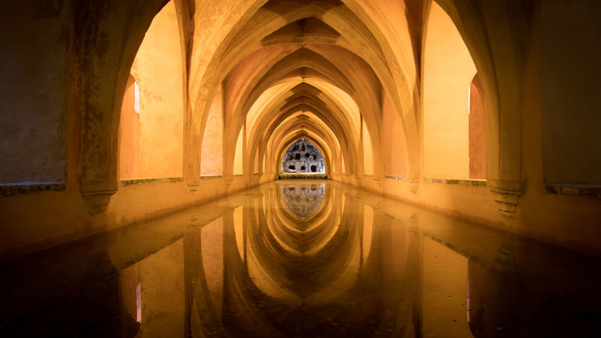 Under the Alcazar Gardens, there's a tub, probably spa and relax baths Bath Roman Bath Tub Arch Architectural Column Architecture Built Structure Corridor Day History Indoors  No People Villa Water Alcazar De Seville