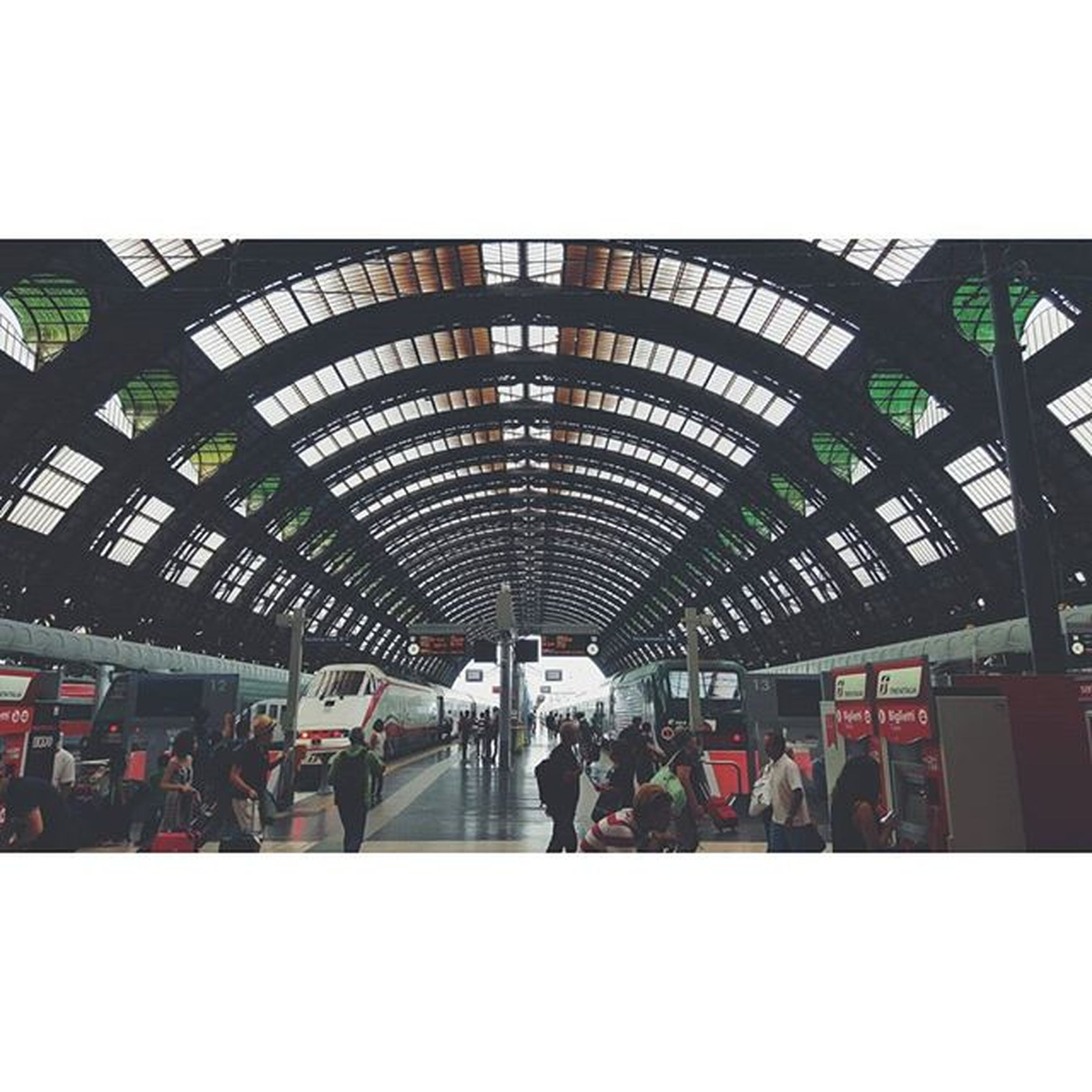 indoors, large group of people, men, transfer print, architecture, railroad station, built structure, person, public transportation, transportation, lifestyles, ceiling, railroad station platform, auto post production filter, walking, city life, travel, rail transportation, leisure activity