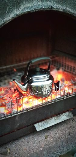 good times with cup of tea made on burning coal.. Night Normandie Calvados France No People Tea Barbecue Vire Friends City Multi Colored Close-up Bonfire Firewood Fire Heat Flame Burning Tea Light