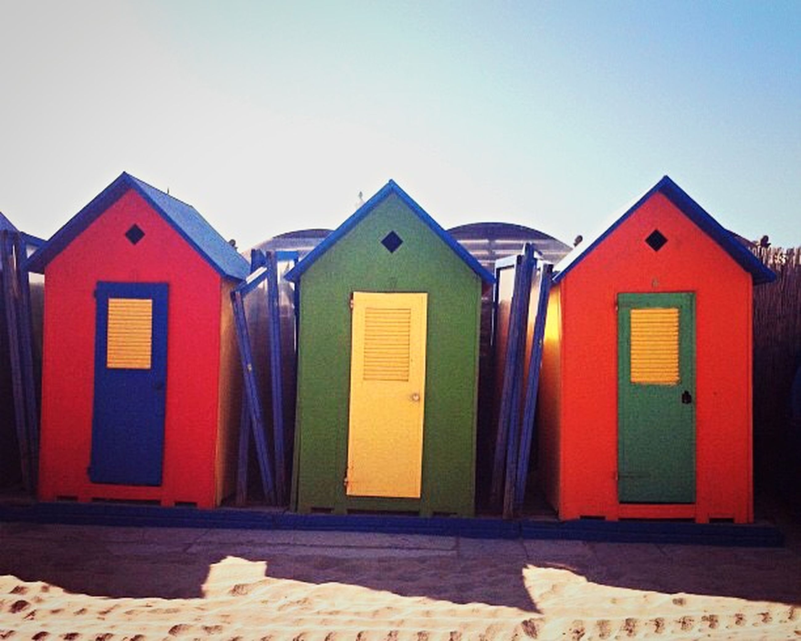 building exterior, architecture, built structure, clear sky, copy space, house, multi colored, side by side, in a row, window, residential structure, blue, beach hut, residential building, red, no people, day, closed, outdoors, colorful
