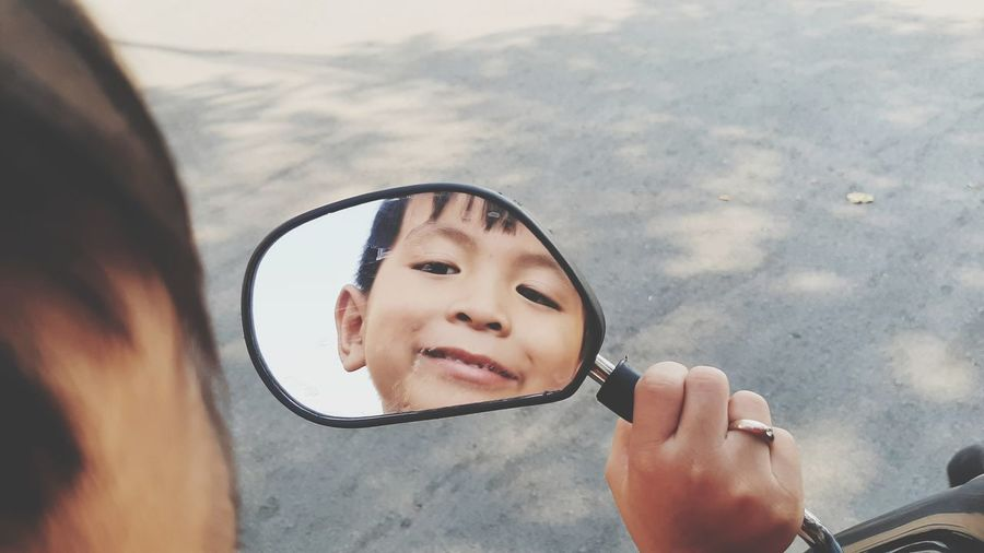 Portrait of boy with reflection on glass