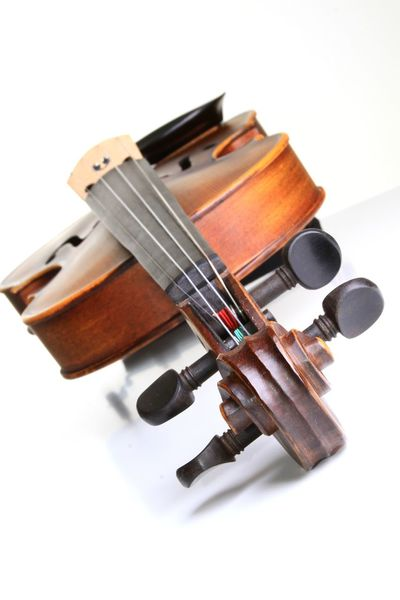 musical violin sitting on a table Keys String Table Setting Arts Culture And Entertainment Classical Music Close-up Day Indoors  Music Musical Instrument Musical Instrument String No People Plastic Play String Instrument Studio Shot Table Tighten Violin Violinist White Background Wooden Instrument