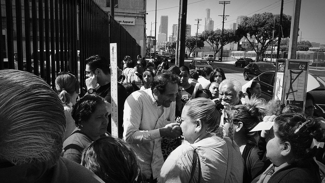 RePicture Travel Dov Charney greeting workers who were laid off outside the gates of American Apparel on the corner of 7th and Alameda in downtown Los Angeles, California on April 1st 2015 Los Angeles, California Black And White Capturing History Downtown Los Angeles American Apparel Dov Charney Greeting AA American Apparel TheWeekOnEyeEM