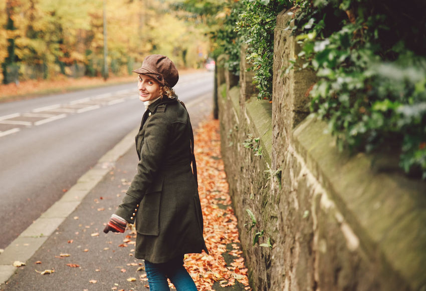 Autumn Colors Hat Leafs Looking Back Road Curly Hair Girl Lifestyles Outdoors Smile Smiling Walking