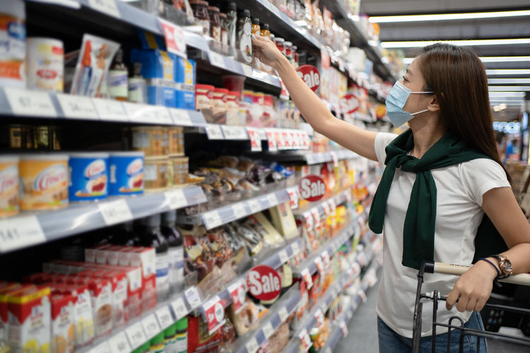 Woman wearing shopping at grocery store