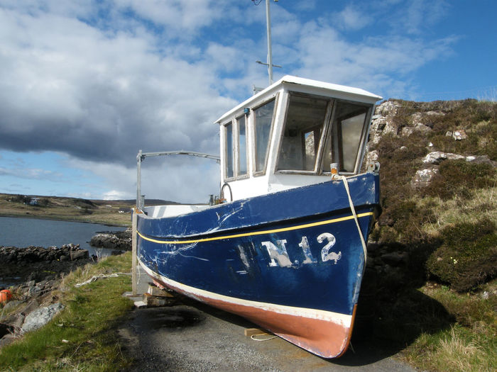 Blue Boat Blue Sky Blue Sky And White Clouds Caroy Jetty Coast Life Coastal Scenery Day Fishing Boat Isle Of Skye Loch Caroy N.12 Nature Nautical Vessel No People Out Of Water Outdoors Scotland Sea Shore Sky Working Boat