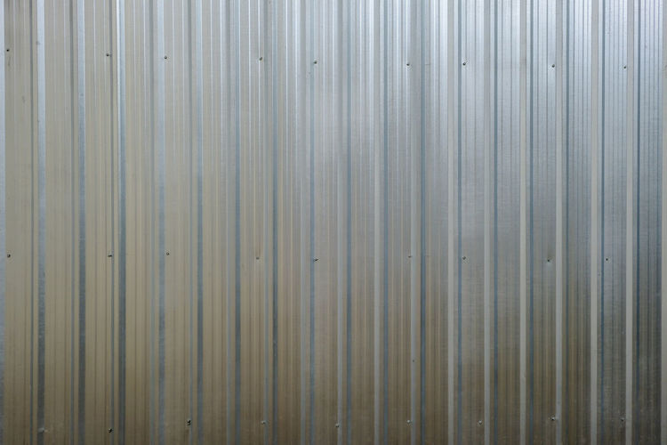 New zinc fence for you. Metallic Fence Zinc Plated Aluminum Backgrounds Fence Full Frame Galvanized Galvanized Fence Gray Metal Metallic Pattern Sheet Metal Silver Colored Zinc Zinc Wall Zinced Fence