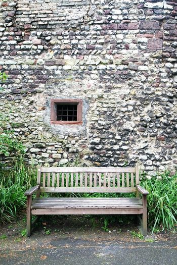 take a seat.... Bench Against Wall Stone Wall Wooden Bench Timbered Bench