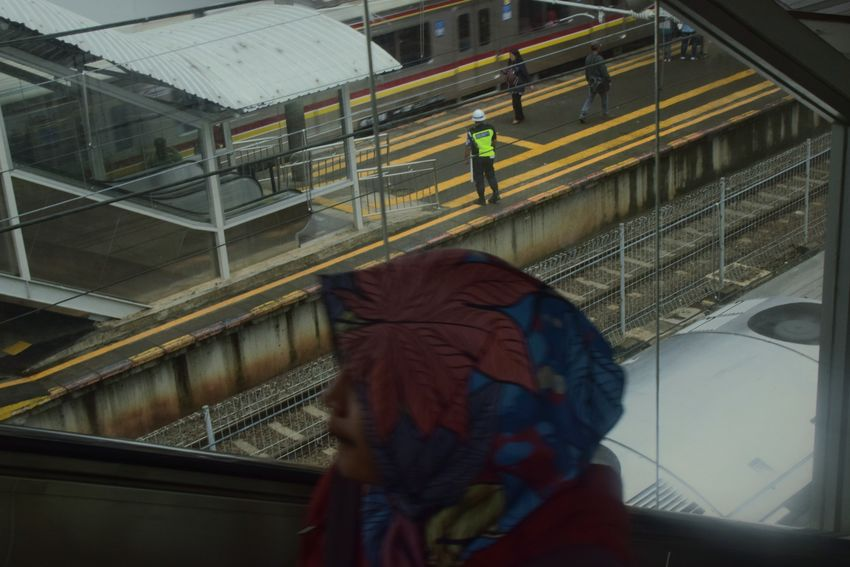 Jakarta, January 2018 Streetphotography Documentaryphotography Train Train Station Commuting Commuter Commute Guard UNPOSED Candid Close-up Day Architecture