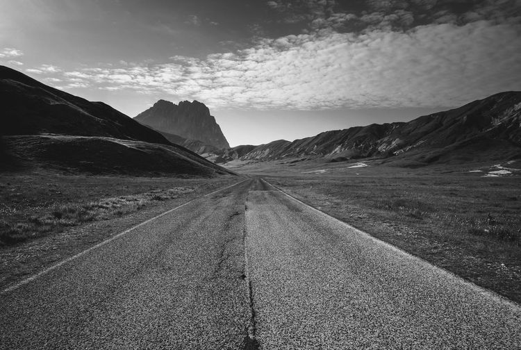 Part of Terraqua ivandimarcophotography.com Beauty In Nature Blackandwhite Campo Imperatore Country Road Countryside Diminishing Perspective Empty Empty Road Landscape Mountain Mountain Range Nature No People Non-urban Scene Outdoors Remote Road Scenics Sky The Way Forward Tranquil Scene Tranquility Vanishing Point Wide Angle