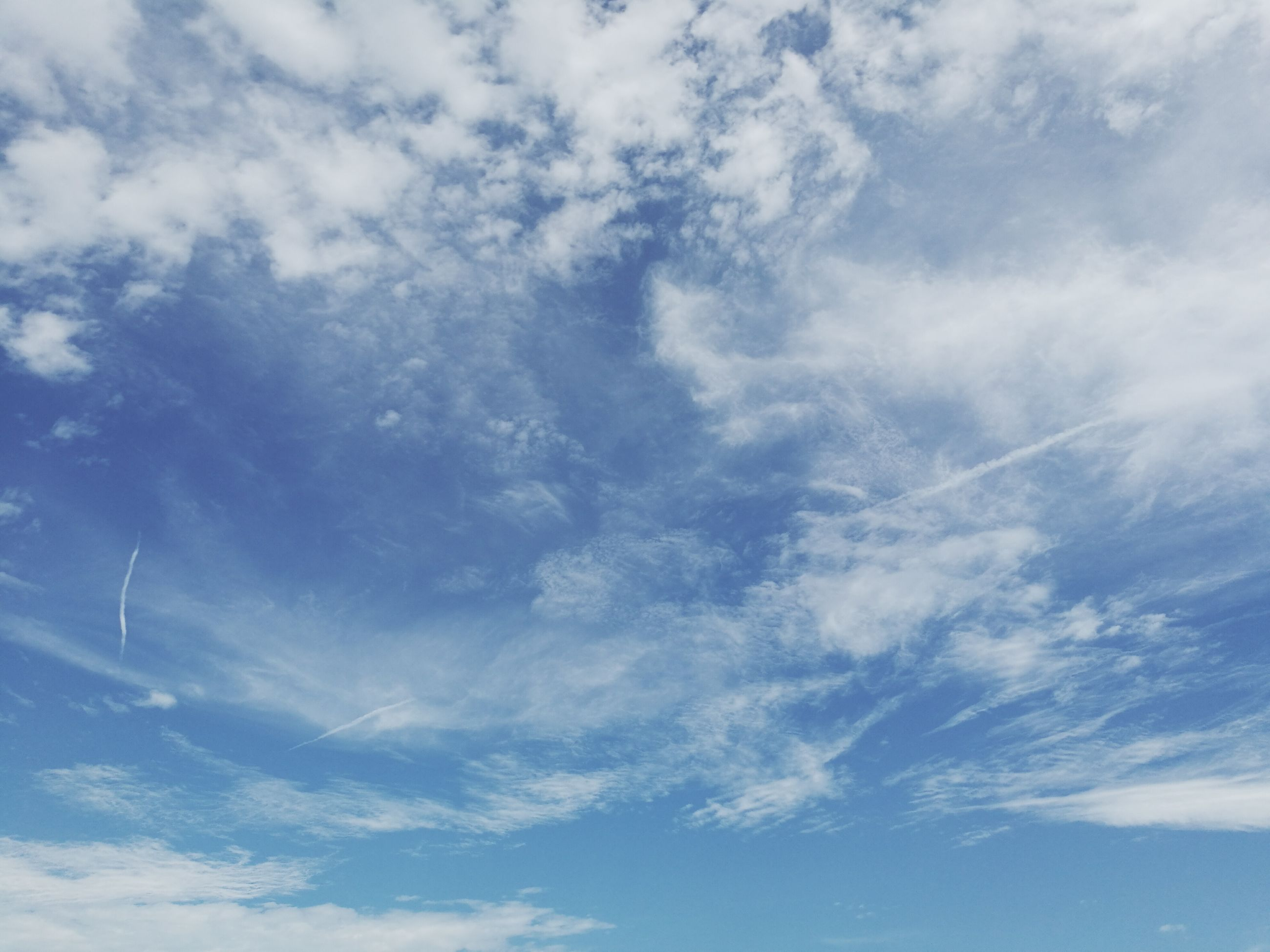 sky, low angle view, cloud - sky, blue, beauty in nature, tranquility, scenics, nature, cloudy, sky only, tranquil scene, backgrounds, cloud, cloudscape, day, idyllic, full frame, outdoors, no people, weather, white, majestic, softness