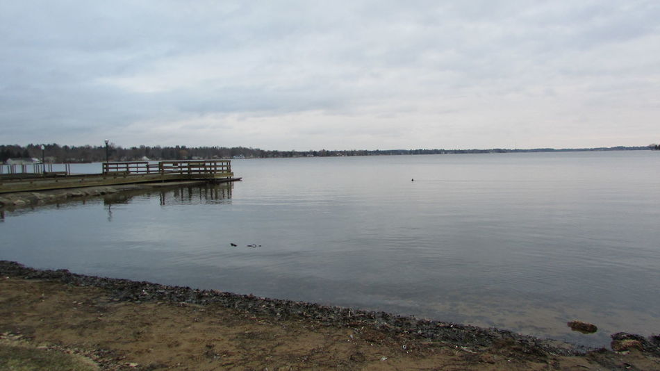 Around The Lake Grey Day Still Water From The Pier Tranquil Scene Lake Cadillac Pure Michigan
