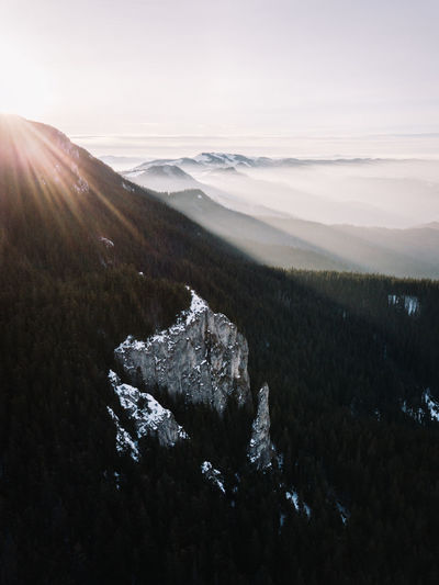 Sky Mountain Beauty In Nature Environment Tranquil Scene Tranquility Scenics - Nature Nature Landscape Sunbeam Lens Flare Sunlight No People Sun Plant Day Non-urban Scene Land Tree Outdoors Bright Snowcapped Mountain Fog Nature Aerial View