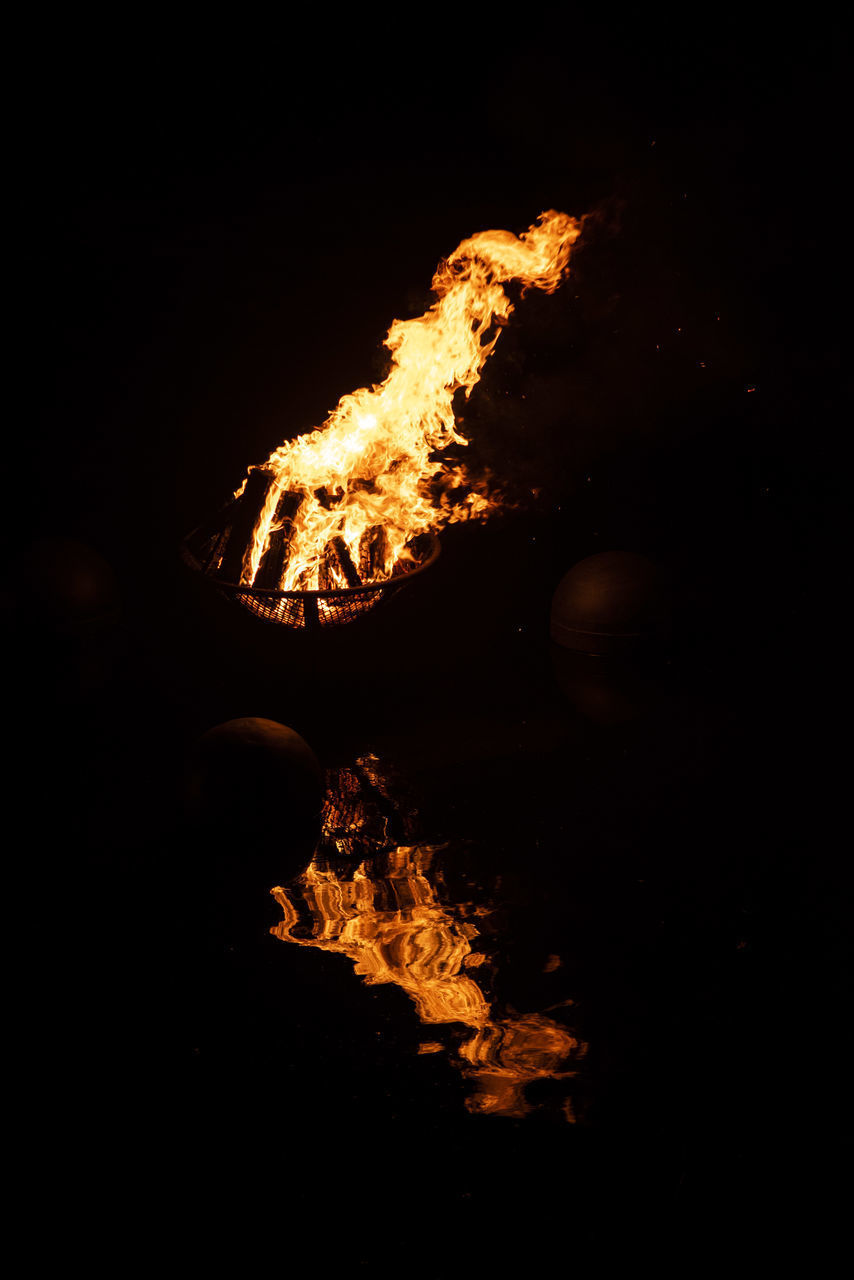 burning, fire, flame, fire - natural phenomenon, heat - temperature, night, motion, bonfire, nature, glowing, no people, dark, orange color, log, black background, close-up, outdoors, campfire, illuminated, event