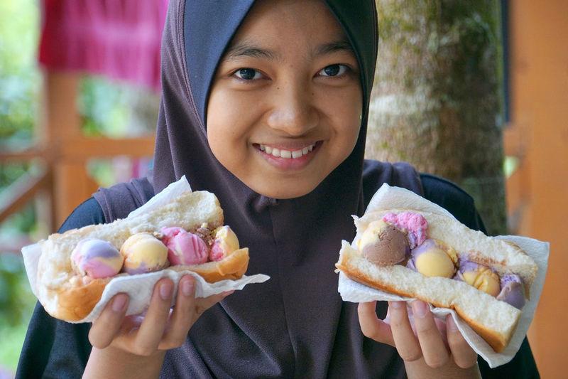 Portrait of woman eating ice cream