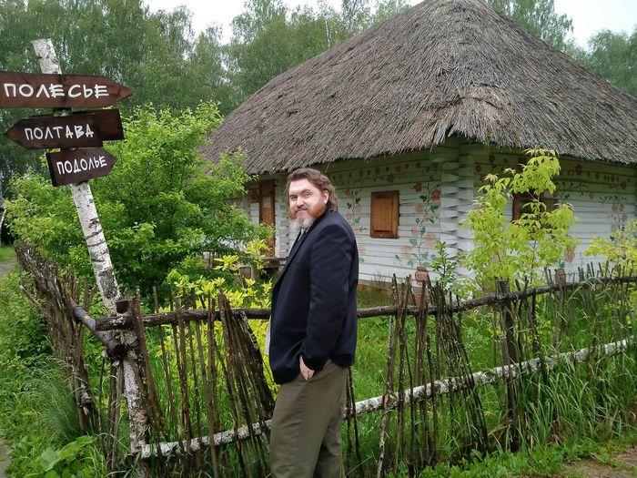 Portrait of man standing against built structure