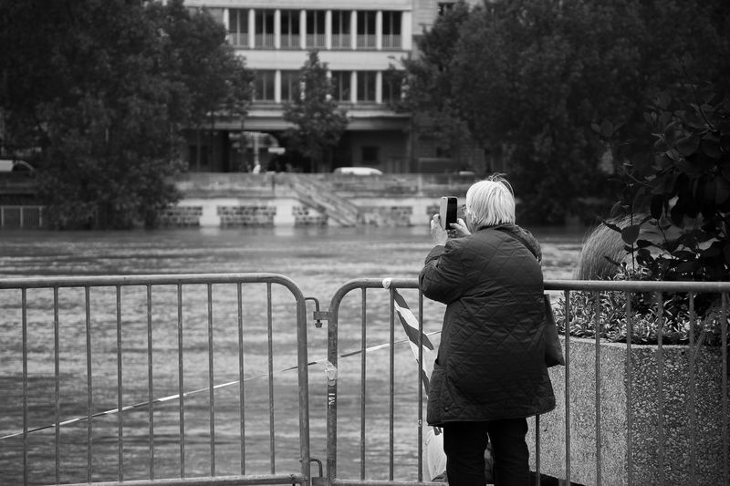 Architecture Blackandwhite Built Structure Bw Canal Casual Clothing City City Life Day Flood France Leisure Activity Lifestyles Mixed Generations Old Woman Outdoors Paris Photographer River Space The Following Travel Destinations Tree Water Women Visual Creativity