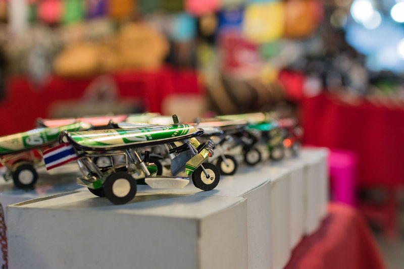 Chiang Mai Chiang Mai Thailand Chiang Mai   Thailand Art And Craft Close-up Focus On Foreground In A Row Indoors  Large Group Of Objects Metal Miniature No People Order Representation Retail  Selective Focus Shopping Sport Still Life Table Toy Toy Car