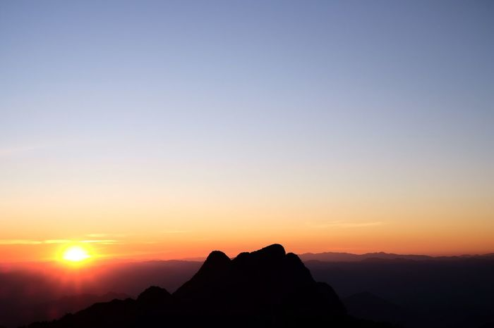 Sun rises Sunset Sky Beauty In Nature Scenics - Nature Silhouette Tranquil Scene Orange Color Mountain Outdoors Sun Environment Mountain Range Nature Rock Tranquility