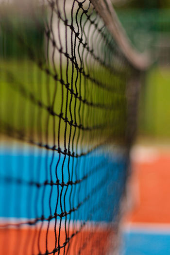 Close-up of net at tennis court
