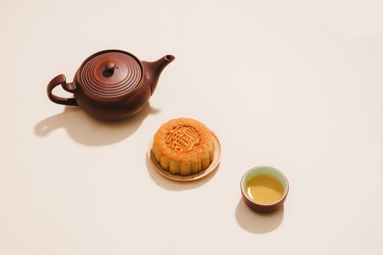 Moon Brown Coffee Coffee Cup Cookie Copy Space Crockery Cup Drink Food Food And Drink Freshness Hot Drink Indoors  Mid-autumn Festival Mug No People Refreshment Snack Still Life Studio Shot Table Tea Cup Teapot