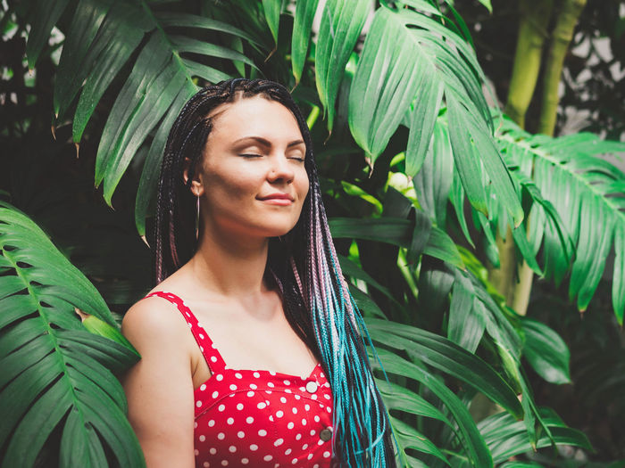 Woman With Dreadlocks Standing Against Plants