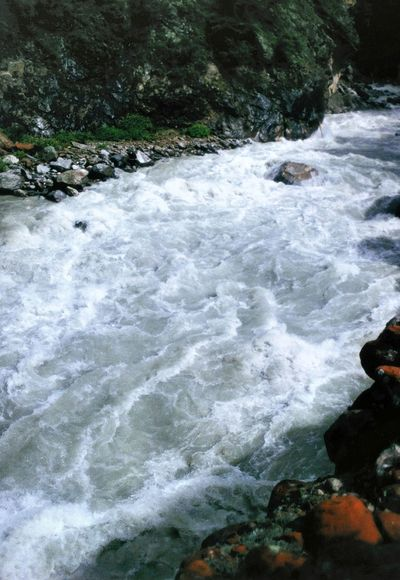 Close-up view of the Dudh Kosi river, somewhere between Lukla and Namche Bazaar, Everest Region, Nepal. This fast-flowing whitewater river cuts a deep gorge between mountains as it flows down from the Everest massif itself. Dudh Kosi Everest Region Namche Bazaar Beauty In Nature Lukla Motion Nature Nepal Travel No People Outdoors River Rock - Object Scenics Water Whitewater