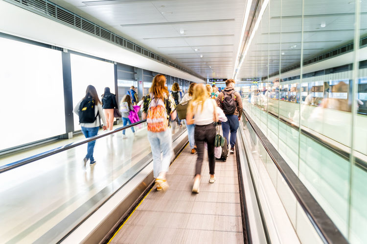 People walking on escalator