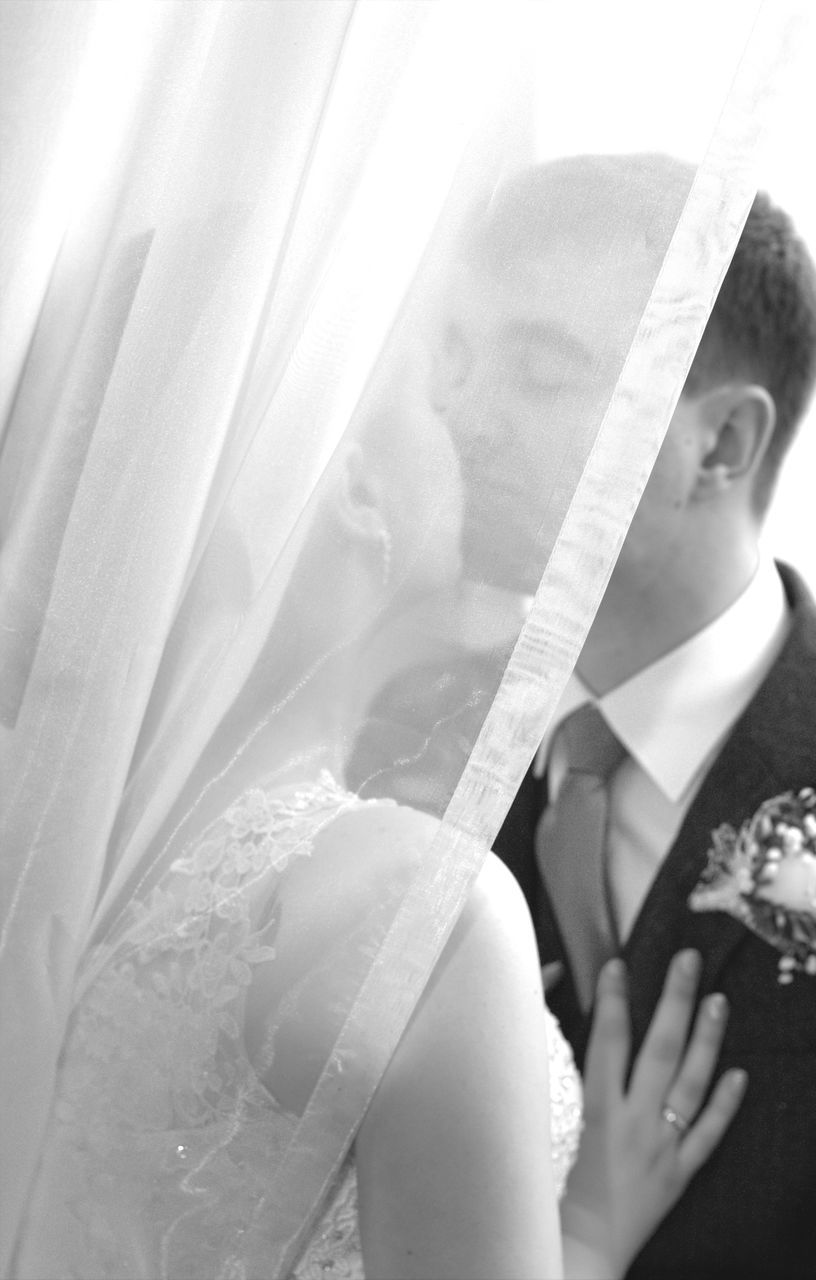 bride, wedding, wedding dress, real people, women, one person, celebration, life events, day, lifestyles, veil, beautiful woman, close-up, indoors, young adult, young women, bridegroom, human hand, people