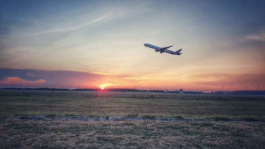 Airplane Flying Sunset Mid-air Air Vehicle Business Finance And Industry Commercial Airplane Sky Landscape Travel