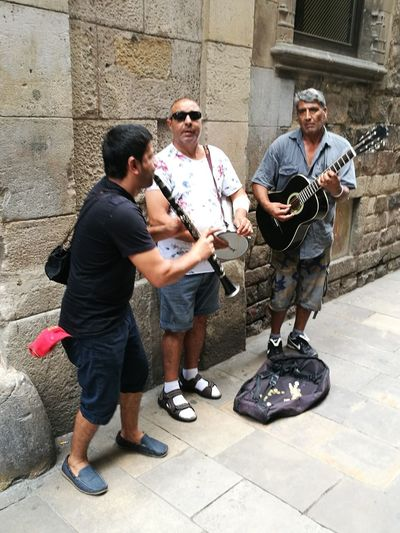 Full Length Only Men Outdoors Arts Culture And Entertainment Day City Life Building Exterior Adult Leisure Activity Standing Men People Architecture Plucking An Instrument Musician Adults Only City Catalunya Barcelona Cityscape Eyeemphotography Best Shots EyeEm Ciutat Vella BCN