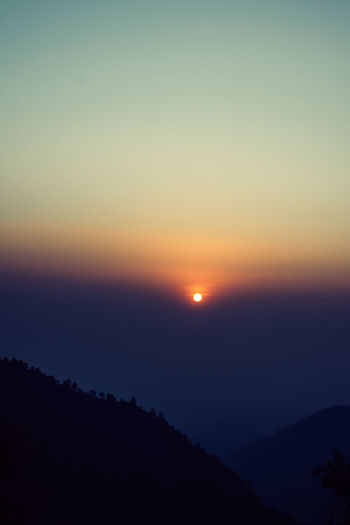 horizon Alone Feeling Moment Sunset_collection Wanderlust Beauty In Nature Clear Sky Colorful Environment Horizon Idyllic Landscape Mountain Nature No People Non-urban Scene Orange Color Outdoors Scenics - Nature Silhouette Sky Sun Sunset Tranquil Scene Tranquility