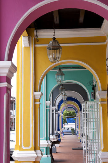 Abstractart Arch Architecture Building Colonial Architecture Corridor Façade Heritage In A Row Malaya Malaysia Malaysian Food Ornate Peranakan Picoftheday Rain Rainbow Colors Rainbow Colours Strait States Symmetrical World Heritage Site Yellow