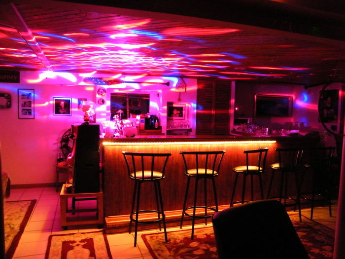 The Puccini Pub Live Entertainment Bar - Drink Establishment Bar Counter Bar Stools In A Row Fun Place  Indoors  Members Only Moving Colors In The Dark Nightlife