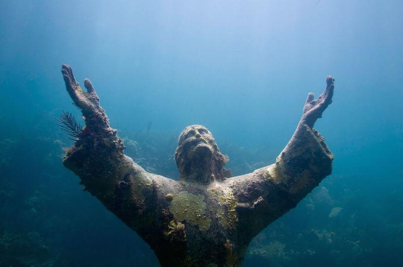 Close-up of jesus christ statue in sea