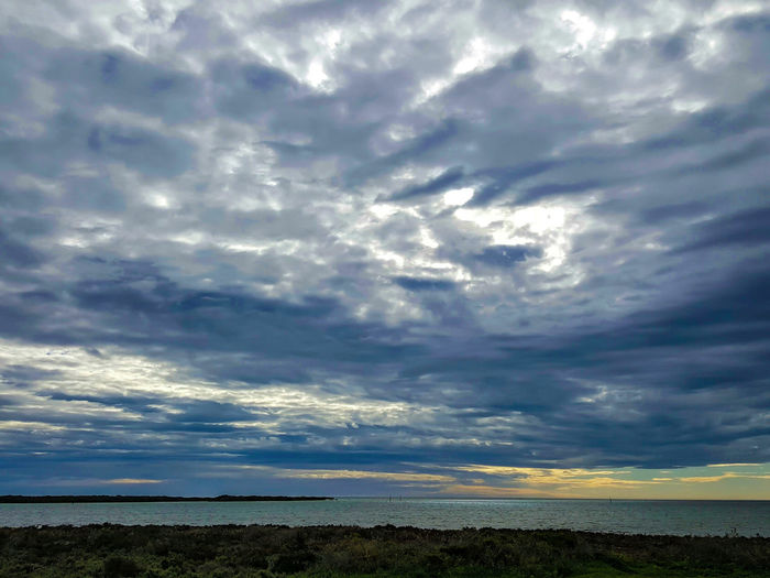 Cloud - Sky Scenics Nature Dramatic Sky Landscape Outdoors Extreme Weather Storm Thunderstorm Sky Storm Cloud No People Beauty In Nature Grass Power In Nature Day Eyeem Market Tranquil Scene Idyllic Silhouette Clouds And Sky Tranquility Outside Photography Beauty In Nature Vacations