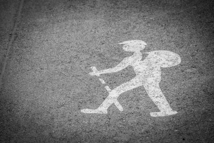 Beware of hikers! Road Sign No People Communication Transportation Representation High Angle View Human Representation Asphalt Marking Day Road Marking Symbol Vignette City Street Guidance White Color Creativity Textured  Message