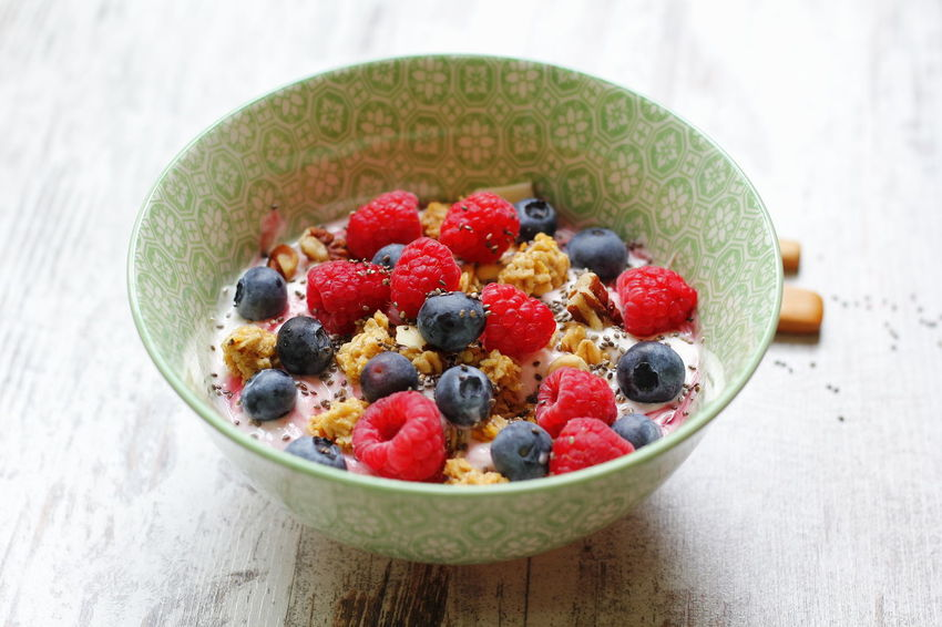 Red fruits in a bowl Cereal Blueberry Bowl Ceramic Cup Close-up Food Food And Drink Freshness Fruit Healthy Eating Indoors  Muesli No People Raspberry Ready-to-eat Red Fruits Yogurt