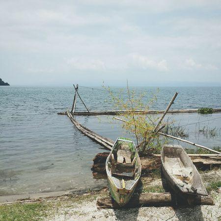 Boats by the shore at Toba Lake Scenics Latepost