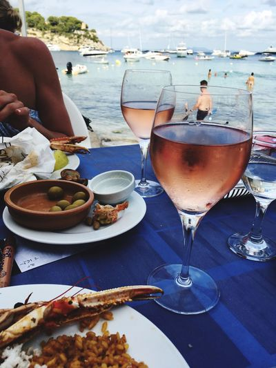 Food And Drink Real People Water Sea Drink Table Leisure Activity Food Lifestyles Nautical Vessel Day Plate Women Freshness Healthy Eating Drinking Glass Balearic Islands Mallorca Islas Baleares Holidays Vine Rosado Seabreeze Seascape Sea And Sky