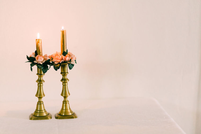 Candle Indoors  Flame Fire Table Burning Candlestick Holder No People Fire - Natural Phenomenon Copy Space Still Life Close-up Wall - Building Feature Studio Shot Wood - Material Decoration Heat - Temperature Celebration Nature
