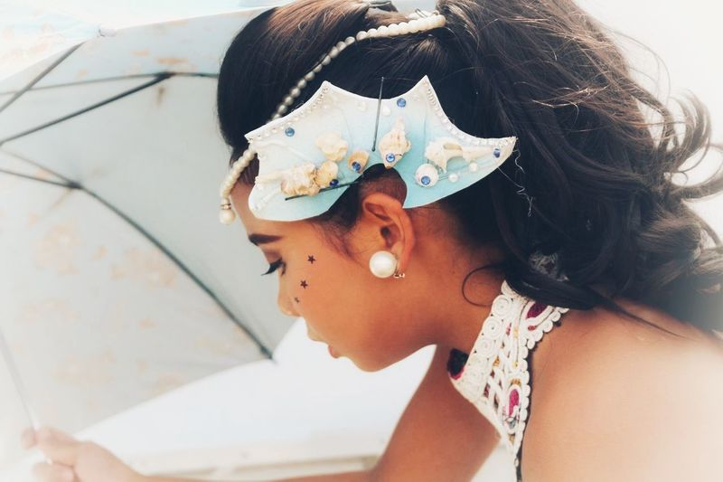 Side view of girl wearing headdress