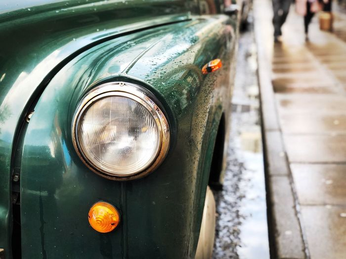 Visual Creativity Rainy Days City Life Parking vanishing point Vintage Car Taxi Old Car Transportation Car Mode Of Transportation Motor Vehicle Headlight Land Vehicle Focus On Foreground City Close-up Retro Styled Street Outdoors Metal